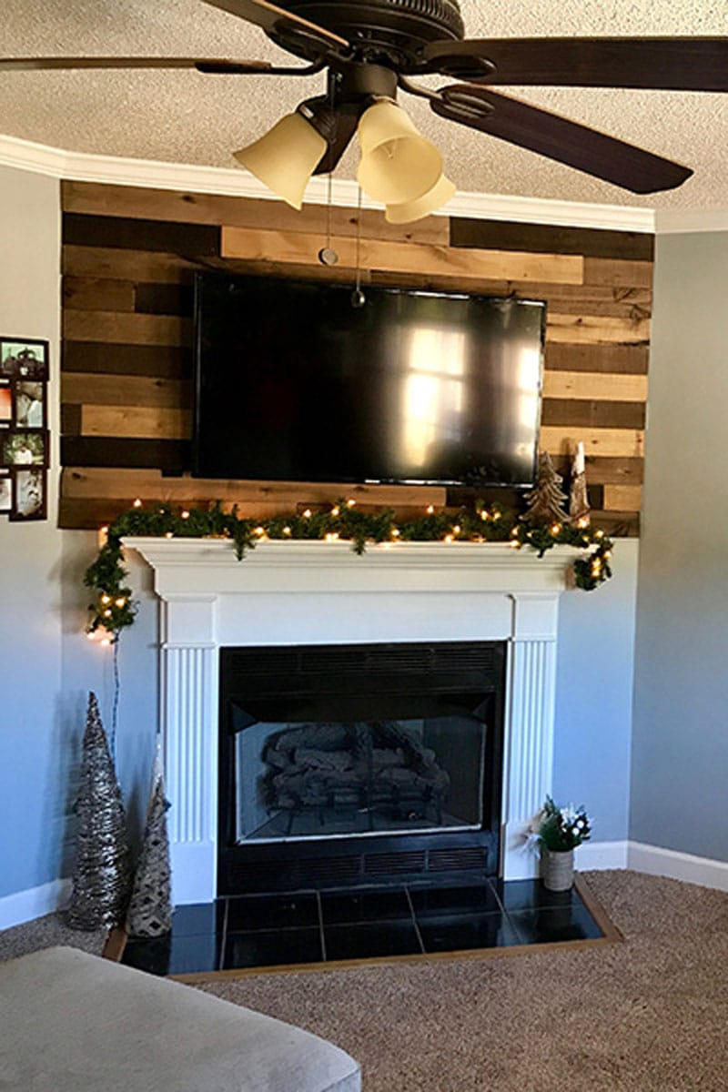 A beautiful wood planked wall using Weaber Wethered Boards that add a simple rustic feel to our living room