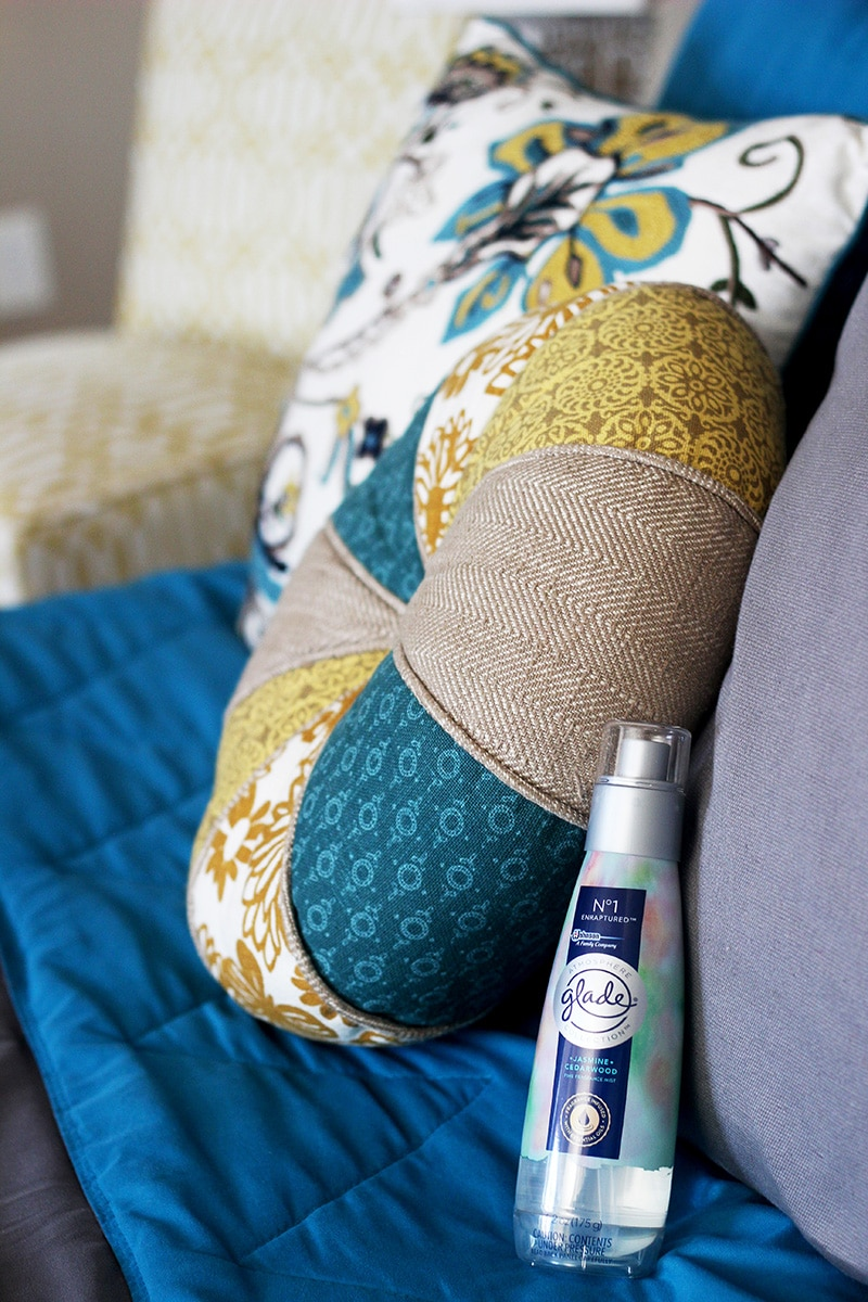 glade fine fragrance mist on bed next to pillows