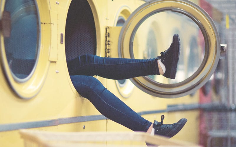 Am I A Homemaker | woman's feet hanging out of washing machine