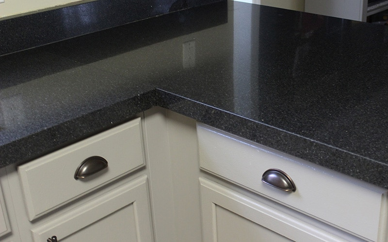 black granite countertops with gray kitchen cabinets