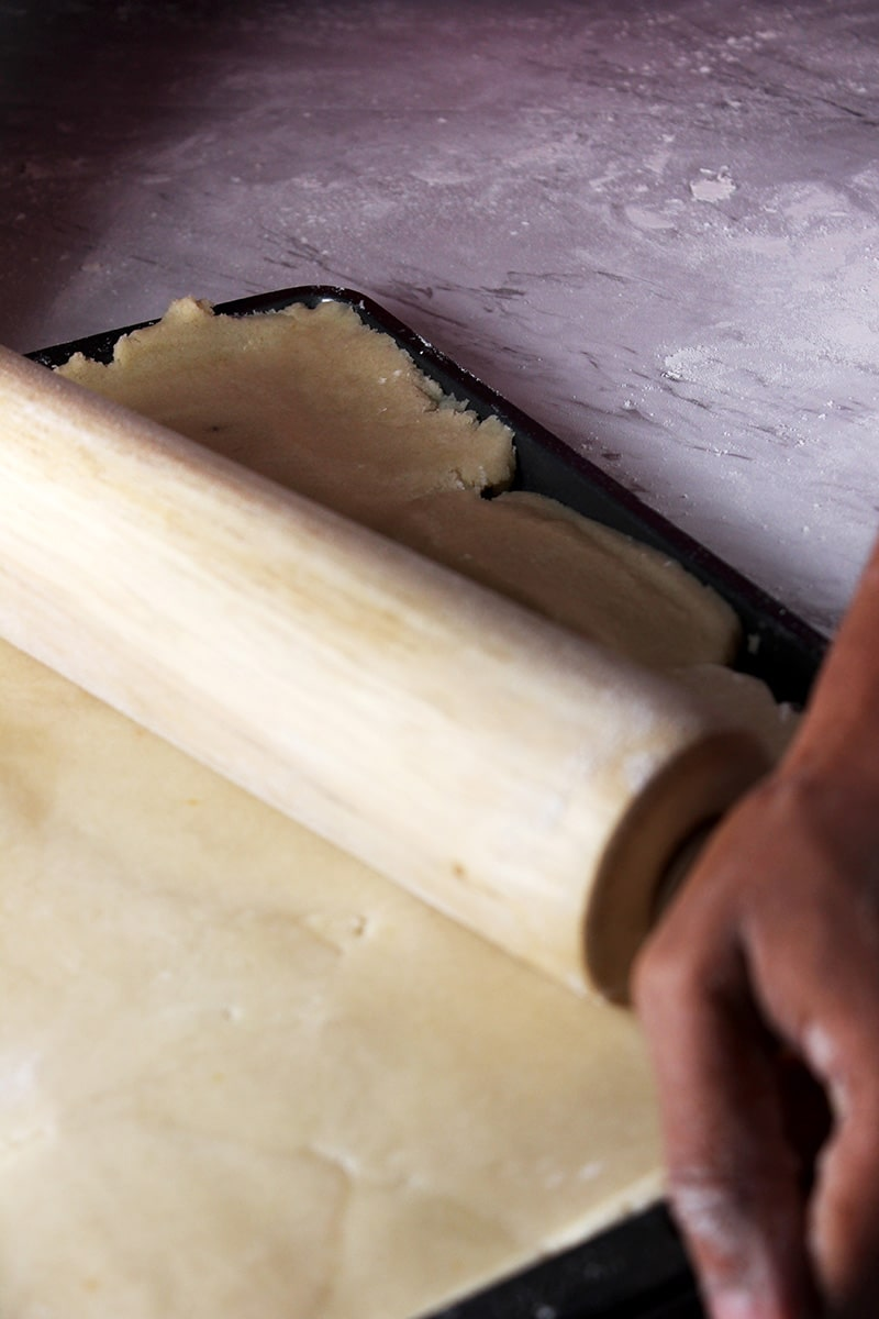 rolling out cookie dough crust with rolling pin