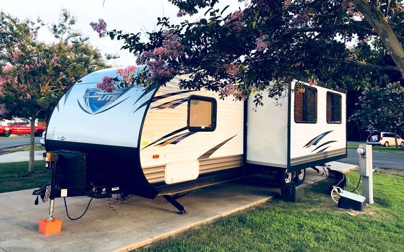 travel trailer parked at campsite