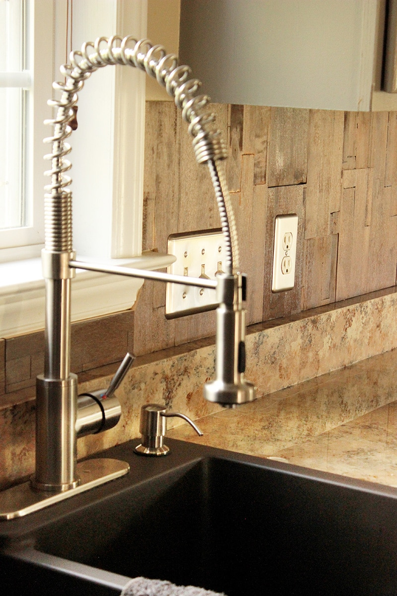 How to install a new sink and faucet.  Along with my review of my new Miseno faucet and sink from build.com after installation. #kitchenproject #kitchensink #howtoinstallakitchensink