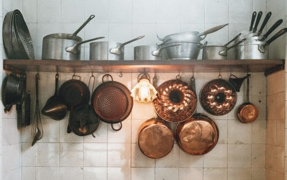 pots and pans hanging on kitchen wall