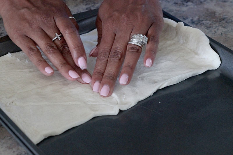sealing creases of crescent rolls