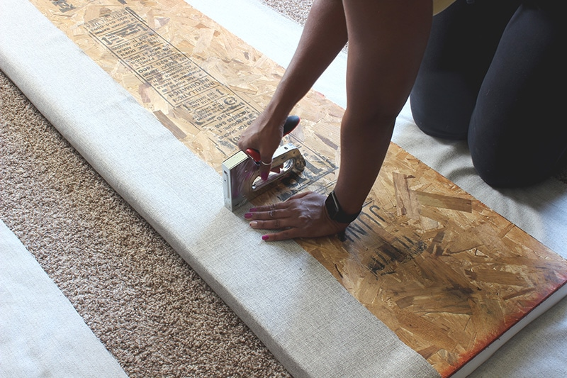 attaching fabric to board with staple gun