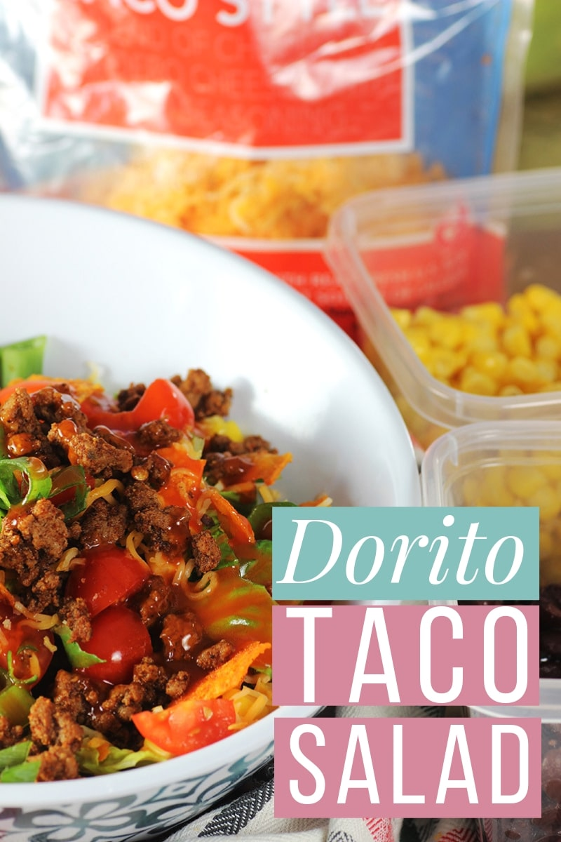 This Dorito Taco Salad is a Taco Tuesday dish that is simple and easy, can be made ahead, and served as a side or main meal. #tacosalad #salad #doritos #30minutemeals #familymeals #saladrecipes