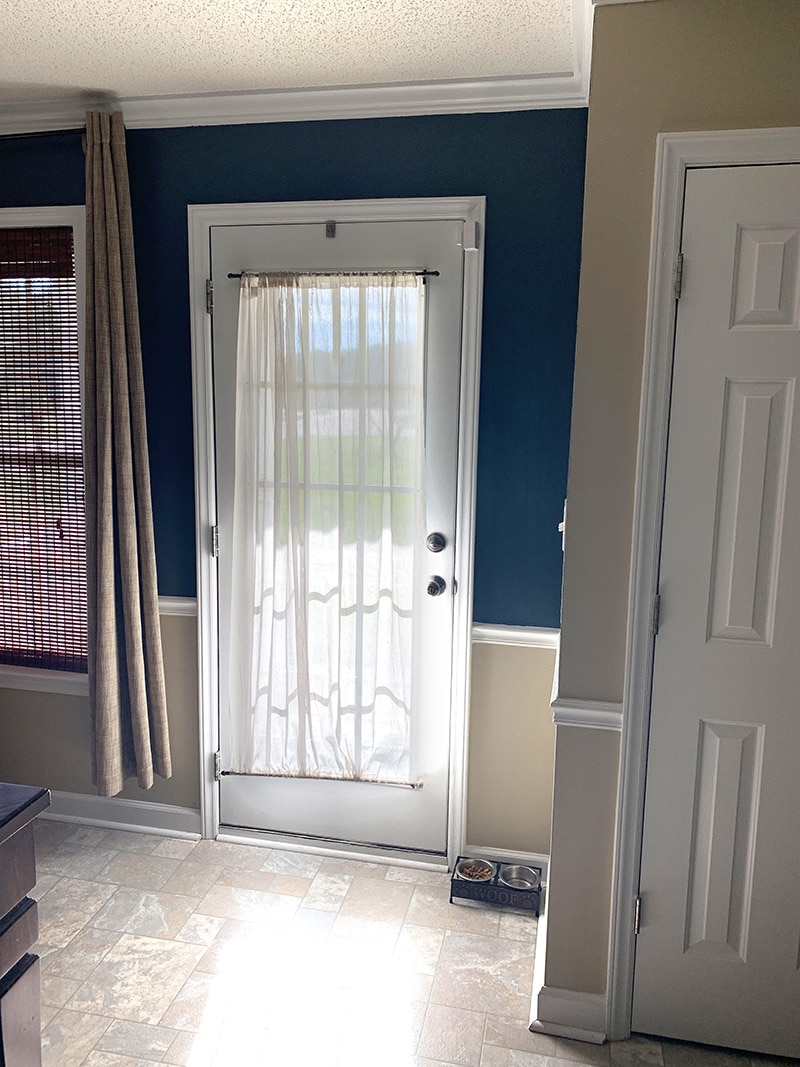 front door with sheer curtain