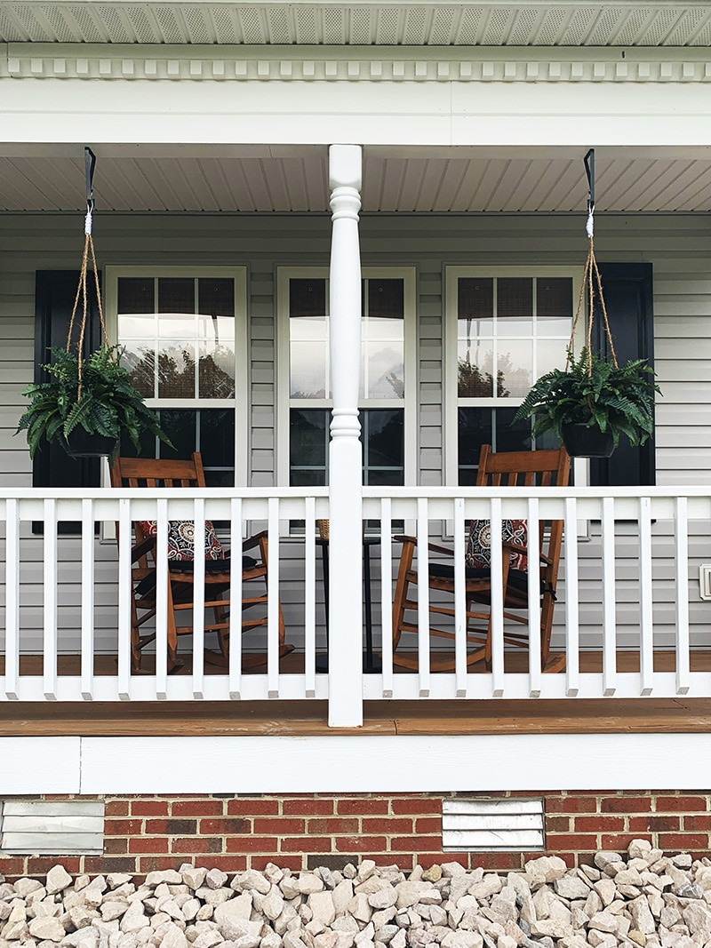 beautiful southern porch with hanging ferns