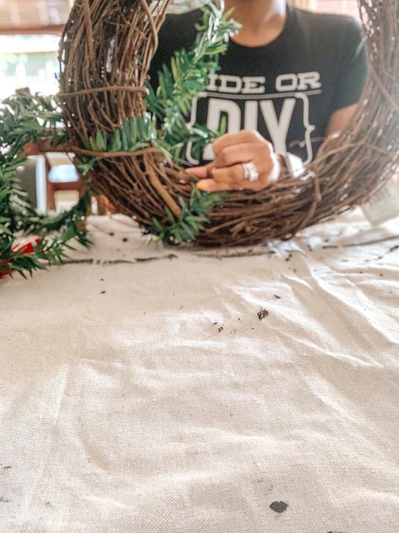 wrapping mini leaf garland around twig wreath