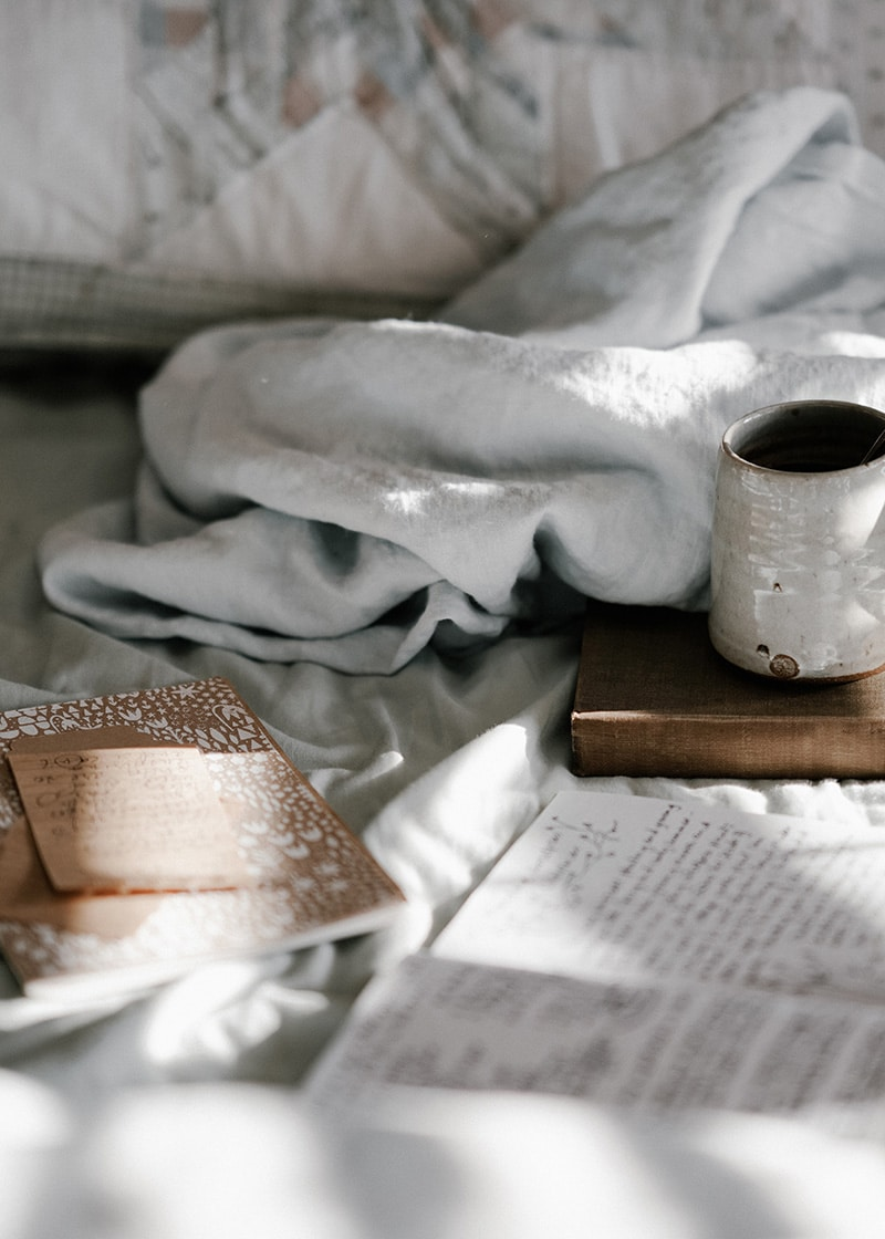 comfortable bed with cup of tea