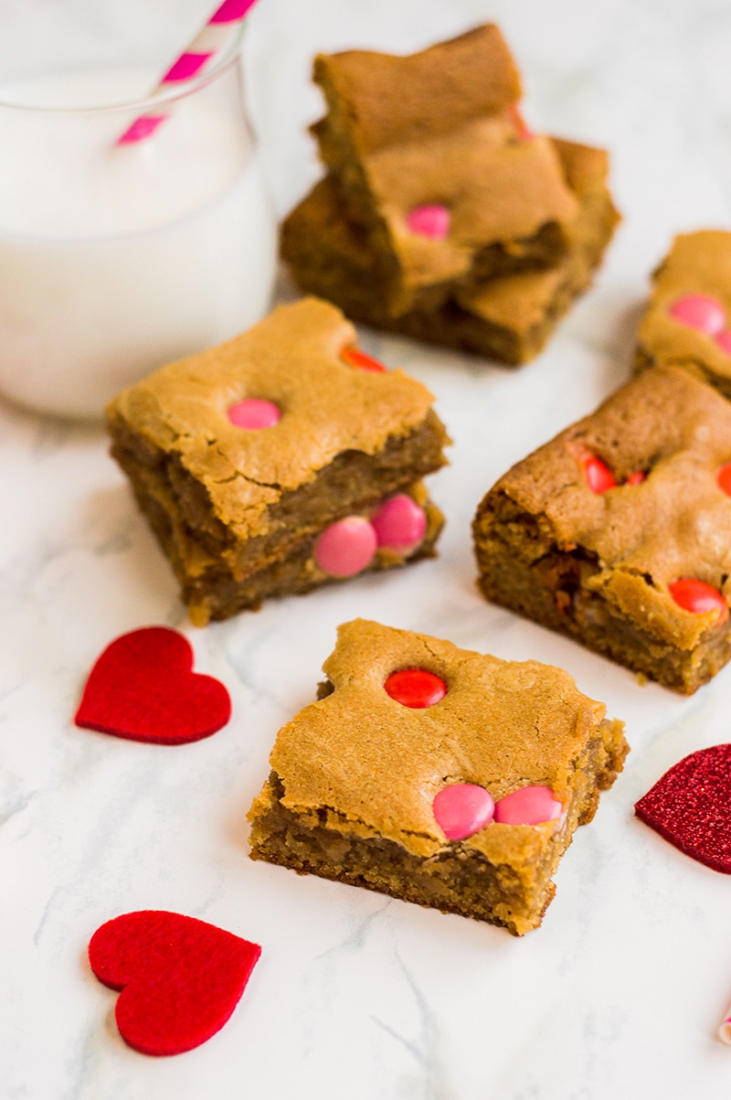 delicious blond brownies made with valentine's M&M candies.