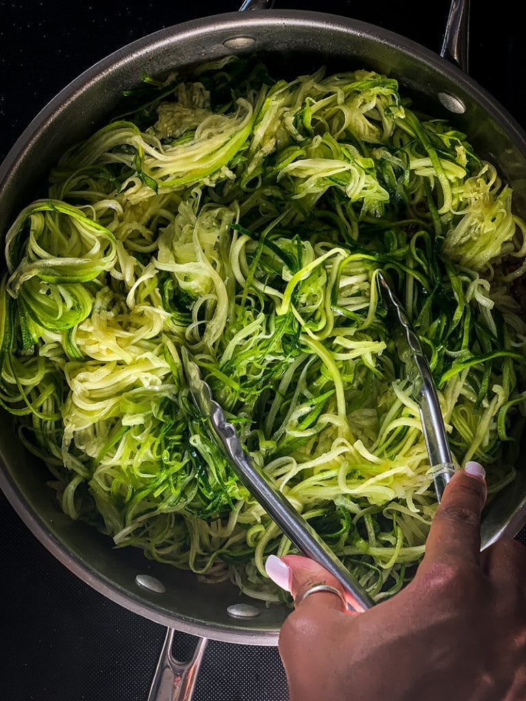 cooking garlic butter zoodles