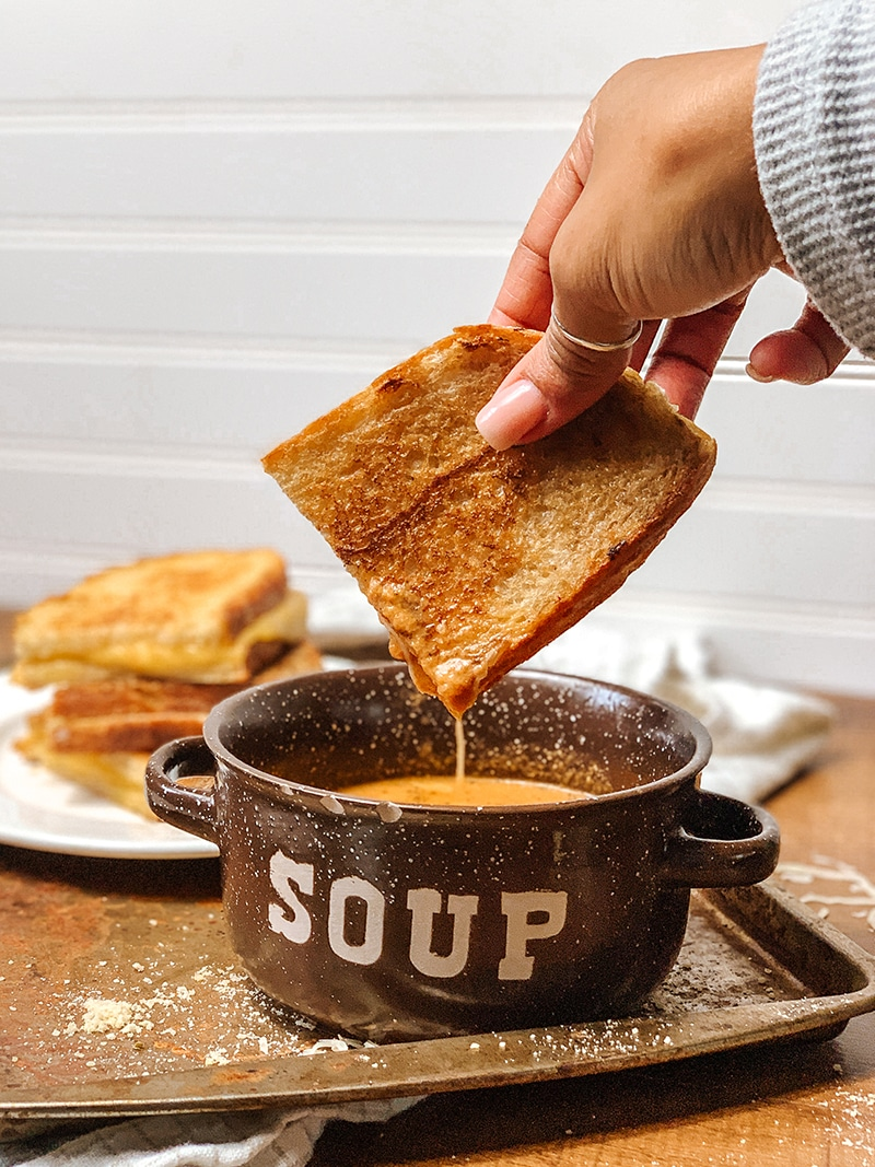 grilled cheese dipped in tomato basil soup
