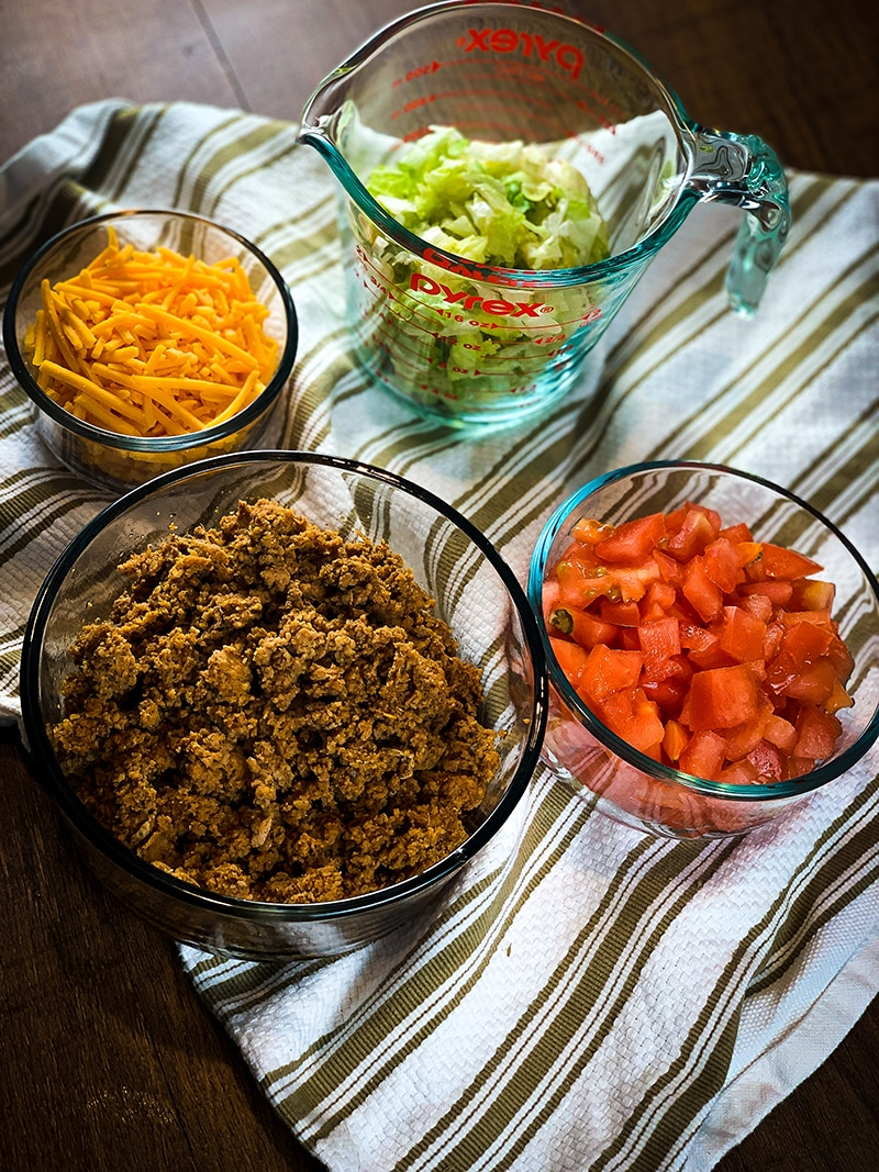 instant pot taco meat, shredded cheese, lettuce and tomatoes